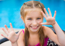 Little girl near sweaming pool Stock Photography