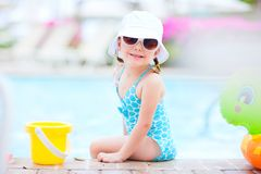 Little girl near swimming pool Stock Photo