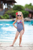Little girl near swimming pool Stock Images