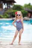 Little girl near swimming pool Stock Images