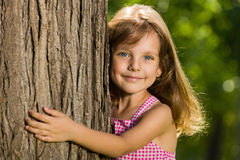 Little girl near a tree Royalty Free Stock Image