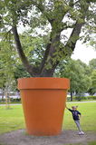 Little girl near the very big pot. Royalty Free Stock Image