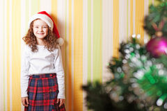 Little girl near wall Royalty Free Stock Images
