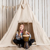 Little girl near wigwam playing Indian Royalty Free Stock Images