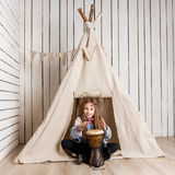Little girl near wigwam playing Indian Royalty Free Stock Photography