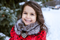 Little girl near in the winter park Royalty Free Stock Image