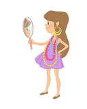 The little girl in the necklace and earrings looks at himself in the mirror. Stock Image