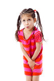 Little girl need a pee. Isolated on white royalty free stock photography