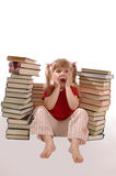 The little girl needs to read many books. The girl expresses emotions concerning books stock photo