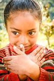 Little girl from Nepal gesturing with her hands Stock Images
