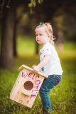 Little girl with nesting box Stock Images