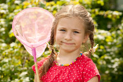 Little girl with a net Stock Photo