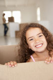 Little girl in new home. Smiling at camera Stock Photos