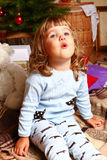 Little girl with a new year or Christmas tree Royalty Free Stock Photography