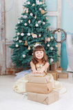 Little girl with a New Year gift. Girl with a New Year gift stock photography