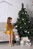 Little girl New Year gifts Stock Photo