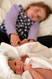 Little girl and newborn sister Royalty Free Stock Photography
