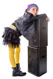 A little girl next to a loudspeaker Royalty Free Stock Photos