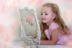 The little girl next to a mirror Royalty Free Stock Images