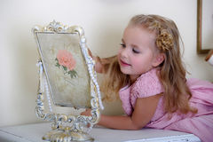 The little girl next to a mirror Stock Photo