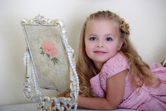 The little girl next to a mirror Royalty Free Stock Image