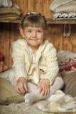 The little girl next to the wardrobe Royalty Free Stock Photos
