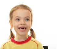 Little girl with no teeth. Stock Photos
