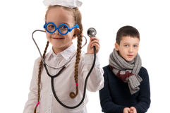 Little girl in nurse costume. Boy ill flu. Stock Image