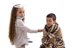 Little girl in nurse costume. Boy ill flu. Royalty Free Stock Photography