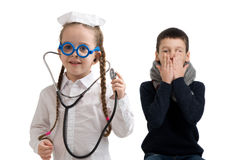 Little girl in nurse costume. Seasonal flu epidemic. Seasonal flu epidemic. little girl in nurse costume. Boy ill flu Stock Image