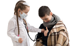 Little girl in nurse costume. Seasonal flu epidemic. Seasonal flu epidemic. little girl in nurse costume. Boy ill flu Stock Photos