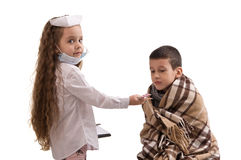 Little girl in nurse costume. Seasonal flu epidemic. Boy ill flu. boy taking pills Royalty Free Stock Image