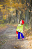 The little girl in the oak grove Royalty Free Stock Photography