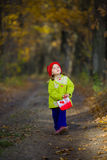 The little girl in the oak grove Stock Photo
