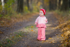 The little girl in the oak grove Royalty Free Stock Photo