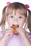 Little girl with oatmeal cookies Stock Photography