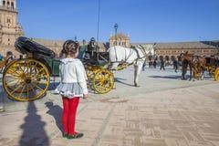 Little girl observing the Plaza de Espana Stock Image