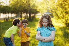 Little girl offended after quarrel to his brothers. Stock Photo