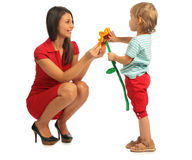 Little girl offer flower to woman Stock Photography