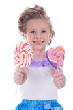 Little girl offer two lollipops Stock Image
