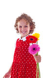 Little girl offering flowers Royalty Free Stock Photo