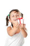 Little girl offering a gift Royalty Free Stock Images