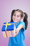 Little girl offering a gift Royalty Free Stock Photography