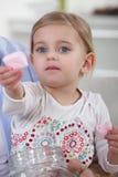 Little girl offering marshmallows Stock Photos