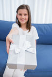Little girl offering a silver gift Stock Photo