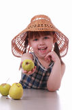 A little girl offers an apple Stock Images