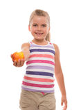 Little girl offers a nectarine Royalty Free Stock Images