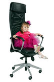 Little girl in an office chair black Royalty Free Stock Image