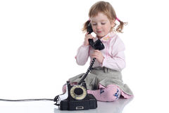 Little girl with old black phone. Stock Photo