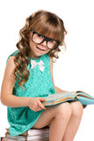 Little girl and old books Stock Photo